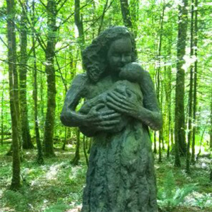Mother and baby statue forest